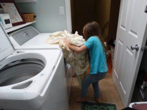 Children doing laundry