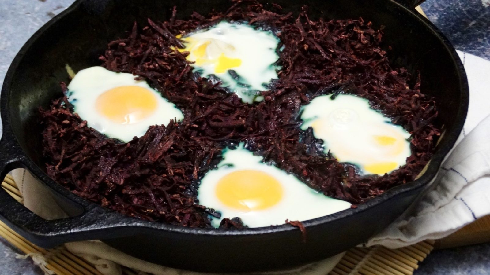 Skillet Baked Eggs Nested in Hashed Purple Sweet Potatoes 4